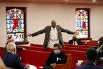 Bishop Thomas Wesley Weeks stands as he speaks to Democratic presidential candidate, former Vice President Joe Biden, left, at Bethel AME Church in Wilmington, Del., Monday, June 1, 2020. (AP Photo/Andrew Harnik)