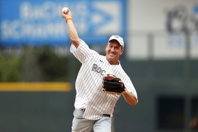 Peyton Manning throws out the ceremonial first pitch prior to the 91st MLB baseball All-Star Game, Tuesday, July 13, 2021 in Denver. (AP Photo/Alex Trautwig, Pool)