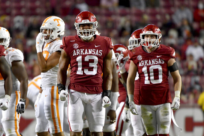 Arkansas defensive players Julius Coates (13) and Bumper Pool (10) celebrate after a play against Tennessee during the first half of an NCAA college football game Saturday, Nov. 7, 2020, in Fayetteville, Ark. (AP Photo/Michael Woods)