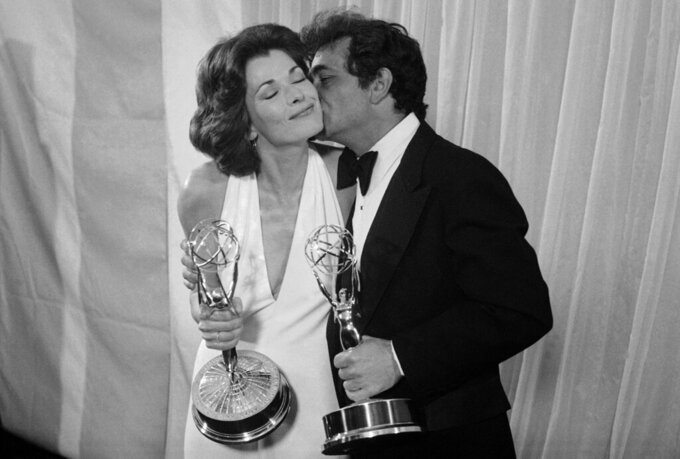 "FILE - Peter Falk of ""Columbo"" gives Jessica Walter of ""Amy Prentice"" a kiss after both won Emmys on May 19, 1975. Walter won for best actress in a limited series while Falk was named best actor in a lined series. Walter, who played a scheming matriarch in TV's ""Arrested Development,"" has died. She was 80. Walter's death was confirmed Thursday, March 25, 2021, by her daughter, Brooke Bowman. The actor's best-known film roles included playing the stalker in Clint Eastwood's 1971 thriller, ""Play Misty for Me."" (AP Photo, File)"
