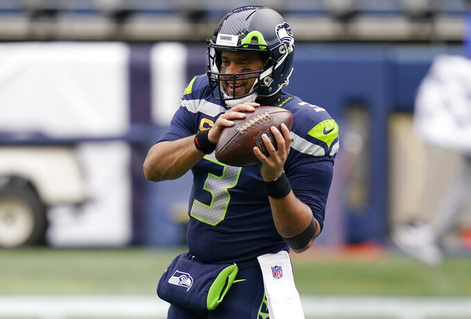 Seattle Seahawks quarterback Russell Wilson (3) warms up before an NFL football game against the Los Angeles Rams, Sunday, Dec. 27, 2020, in Seattle. (AP Photo/Elaine Thompson)