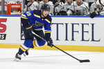 FILE - St. Louis Blues' Ivan Barbashev (49) handles the puck against the Los Angeles Kings during the first period of an NHL hockey game in Los Angeles, in this Sunday, Jan. 24, 2021, file photo. The banged-up St. Louis Blues got more bad injury news Tuesday, Feb. 23, 2021, with word that defenseman Carl Gunnarsson won't play again this season and forward Ivan Barbashev is out at least six weeks.(AP Photo/Joe Puetz, File)
