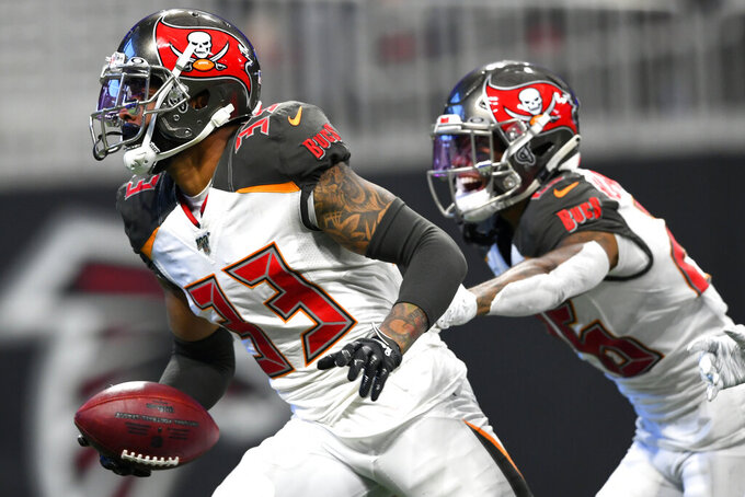 Tampa Bay Buccaneers cornerback Carlton Davis (33) celebrates his interception against Atlanta Falcons wide receiver Calvin Ridley during the second half of an NFL football game, Sunday, Nov. 24, 2019, in Atlanta. (AP Photo/John Amis)