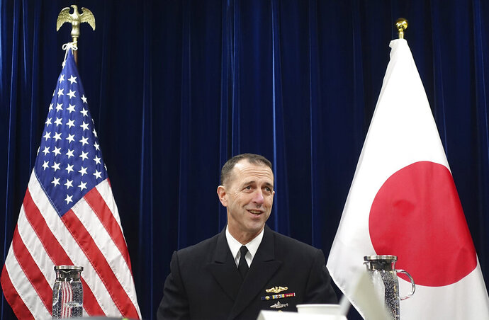 Chief of U.S. Naval Operations Adm. John Richardso talks to reporters on regional security issues in Tokyo Friday, Jan. 18, 2019. The U.S. Navy's top officer says he urged China to follow international rules at sea to avoid confrontations and insisted that ships should be able to pass safely though disputed areas of the South China Sea and Taiwan Strait. (AP Photo/Mari Yamaguchi)