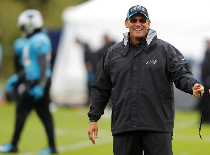 Panthers head coach Ron Rivera smiles during a NFL training session of the Carolina Panthers at Harrow School in London, Friday, Oct. 11, 2019. The Carolina Panthers are preparing for an NFL regular season game against the Tampa Bay Buccaneers in London on Sunday. (AP Photo/Frank Augstein)