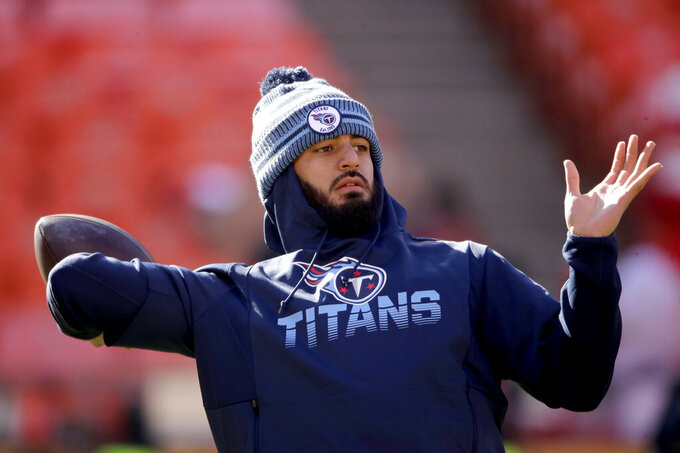 Tennessee Titans' quarterback Marcus Mariota warms up before the NFL AFC Championship football game against the Kansas City Chiefs Sunday, Jan. 19, 2020, in Kansas City, MO. (AP Photo/Charlie Riedel)