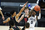 Penn State's Jamari Wheeler (5) passes the ball as Nebraska's Trey McGowens (2) defends during the second half of an NCAA college basketball game at the Big Ten men's tournament Wednesday, March 10, 2021, in Indianapolis. (AP Photo/Darron Cummings)
