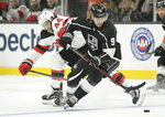 New Jersey Devils left wing Miles Wood, left, reaches in on Los Angeles Kings center Adrian Kempe, of Sweden, during the first period of an NHL hockey game Thursday, Dec. 6, 2018, in Los Angeles. (AP Photo/Mark J. Terrill)