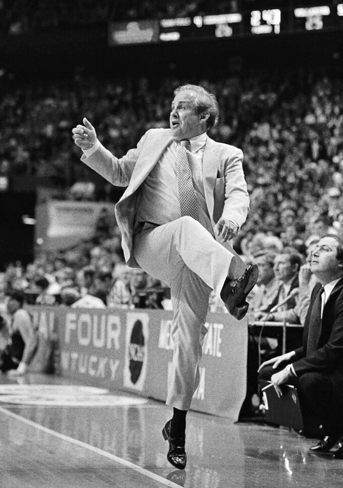 "FILE - In this April 1, 1985, file photo, Villanova coach Rollie Massimino is up on his toes during the NCAA college basketball Final Four championship game against Georgetown, in Lexington, Ky. Underdog Villanova, shooting 79 percent from the field, beat Georgetown 66-64. No one thought we could do it, but I did,"" Villanova coach Rollie Massimino shouted afterward.  (AP Photo/Bob Jordan, File)"