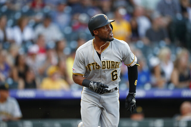 In this Aug. 31, 2019 photo Pittsburgh Pirates center fielder Starling Marte (6) in the first inning of a baseball game in Denver. Marte is heading to the Arizona Diamondbacks. The Pirates sent the two-time Gold Glove outfielder and 2016 All-Star to the Diamondbacks for prospects Liover Peguero and Brennan Malone, Monday, Jan. 27, 2020. (AP Photo/David Zalubowski)