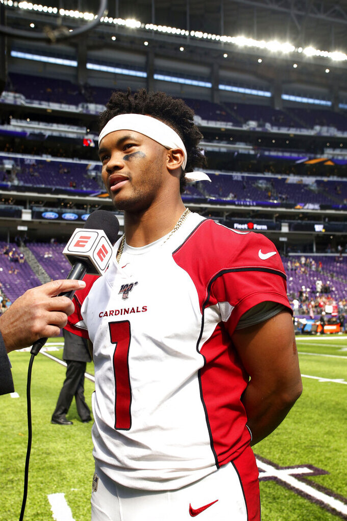 Arizona Cardinals quarterback Kyler Murray is interviewed after an NFL preseason football game against the Minnesota Vikings, Saturday, Aug. 24, 2019, in Minneapolis. The Vikings won 20-9. (AP Photo/Bruce Kluckhohn)