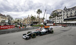 FILE - In this Sunday, May 26, 2019 file photo, leading Mercedes driver Lewis Hamilton of Britain steers his car during the Monaco Formula One Grand Prix race, at the Monaco racetrack, in Monaco. Formula One's raucous circus won't be coming on May 24, 2020 for the iconic Monaco Grand Prix. The race was canceled on March 19 because of the coronavirus outbreak, with the jewel in F1′s crown removed for the first time in 66 years. (AP Photo/Luca Bruno, File)