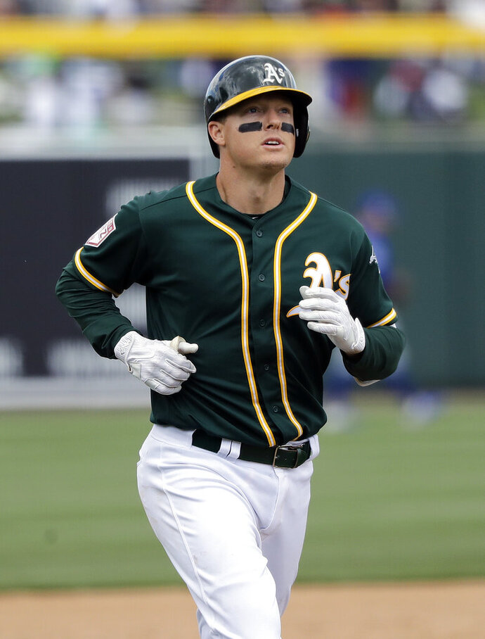 Oakland Athletics' Mike Hundley rounds the bases on his solo home run against the Chicago Cubs in the third inning of a spring training baseball game, Wednesday, March 13, 2019, in Mesa, Ariz. (AP Photo/Elaine Thompson)
