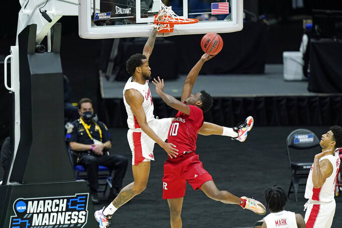Rutgers' Montez Mathis (10) drives against Houston's Justin Gorham, left, during the first half of a college basketball game in the second round of the NCAA tournament at Lucas Oil Stadium in Indianapolis Sunday, March 21, 2021. (AP Photo/Mark Humphrey)