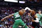 Houston Rockets' Russell Westbrook (0) is fouled by Boston Celtics' Marcus Smart (36) during the first half of an NBA basketball game Tuesday, Feb. 11, 2020, in Houston. (AP Photo/David J. Phillip)