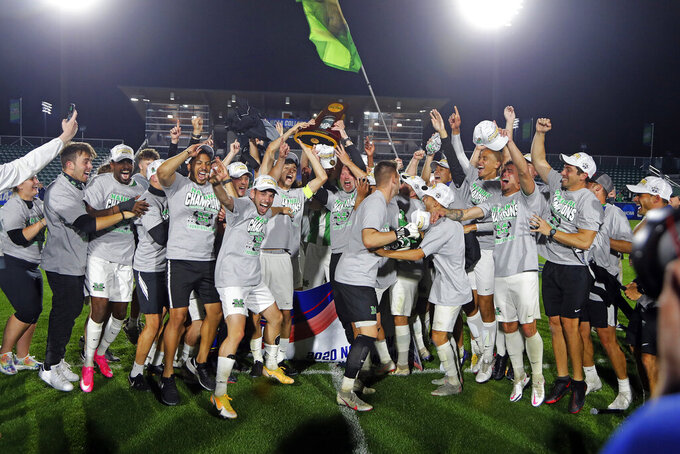 Marshall celebrates winning the NCAA College Cup championship soccer match over Indiana in Cary, N.C., Monday, May 17, 2021. (AP Photo/Karl B DeBlaker)