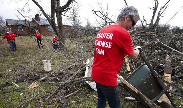 Russ Freeman of Donelson Fellowship church disaster response team works to clean up tornado debris along McGavock Pike Wednesday, March 4, 2020 in Nashville, Tenn. A tornado ripped through the city early Tuesday morning.  (George Walker IV/The Tennessean via AP)