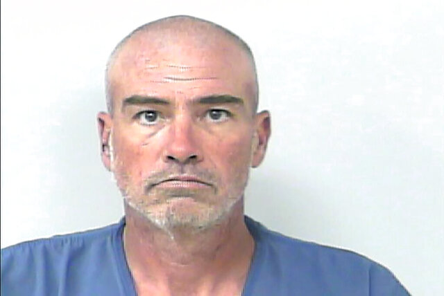 In this undated booking photo provided by the St. Lucie County Sheriff's Office is William Hawkins. Authorities charged Hawkins with first degree murder for allegedly breaking into a Port St. Lucie, Fla., nursing home on Jan. 5, 2020, and suffocating a 95-year-old patient as he slept. Hawkins, 47, was being held Tuesday, Feb. 4, 2020, without bail at the St. Lucie County jail. (St. Lucie County Sheriff's Office via AP)