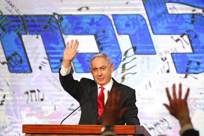 FILE - In this Wednesday, March 24, 2021, file photo, Israeli Prime Minister Benjamin Netanyahu waves to his supporters after the first exit poll results for the Israeli parliamentary elections at his Likud party's headquarters in Jerusalem. Netanyahu missed a midnight deadline for putting together a new coalition government.  His failure to reach an agreement late Tuesday, May 4, 2021, raises the possibility that Netanyahu's Likud party could be pushed into the opposition for the first time in 12 years.  (AP Photo/Ariel Schalit, File)