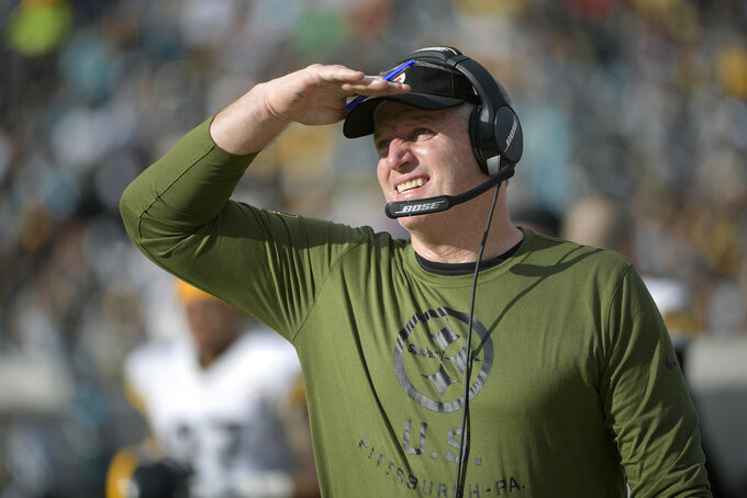 FILE - In this Nov. 18, 2018, file photo, Pittsburgh Steelers offensive line coach Mike Munchak watches from the sideline during the second half of an NFL football game against the Jacksonville Jaguars in Jacksonville, Fla. John Elway met with Munchak about the Denver Broncos' vacant head coaching position Friday, Jan. 2019, one Hall of Famer to another. (AP Photo/Phelan M. Ebenhack, File)