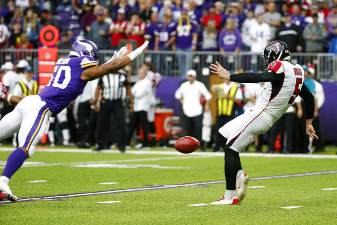 Minnesota Vikings linebacker Eric Wilson, left, blocks a punt by Atlanta Falcons punter Matt Bosher during the first half of an NFL football game, Sunday, Sept. 8, 2019, in Minneapolis. (AP Photo/Bruce Kluckhohn)