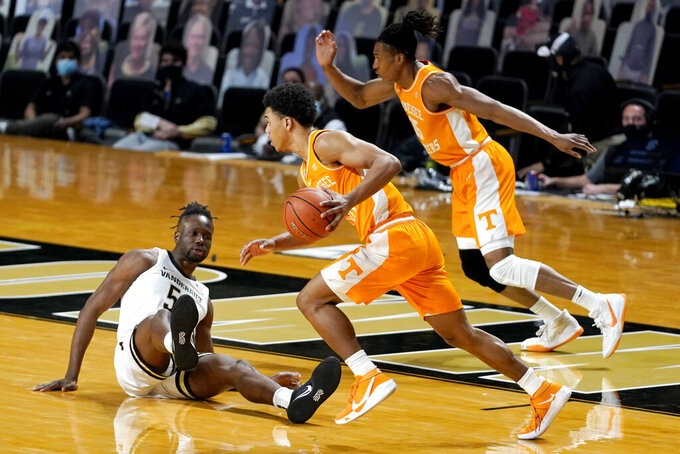 Tennessee's Jaden Springer, center, and Yves Pons, right, head down the court past Vanderbilt's Ejike Obinna (50) in the first half of an NCAA college basketball game Wednesday, Feb. 24, 2021, in Nashville, Tenn. (AP Photo/Mark Humphrey)