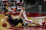 Penn State's John Harrar and Wisconsin's Brad Davison fall going after a loose ball during the first half of an NCAA college basketball game Tuesday, Feb. 2, 2021, in Madison, Wis. (AP Photo/Morry Gash)