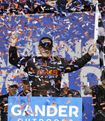 Confetti flutters as Brett Moffitt celebrates after winning the NASCAR Truck Series auto race at Chicagoland Speedway in Joliet, Ill., Friday, June 28, 2019. (AP Photo/Nam Y. Huh)