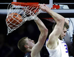 Kansas State forward Dean Wade, right, dunks behind his head over Oklahoma forward Brady Manek, left, during the first half of an NCAA college basketball game in Manhattan, Kan., Saturday, March 9, 2019. (AP Photo/Orlin Wagner)
