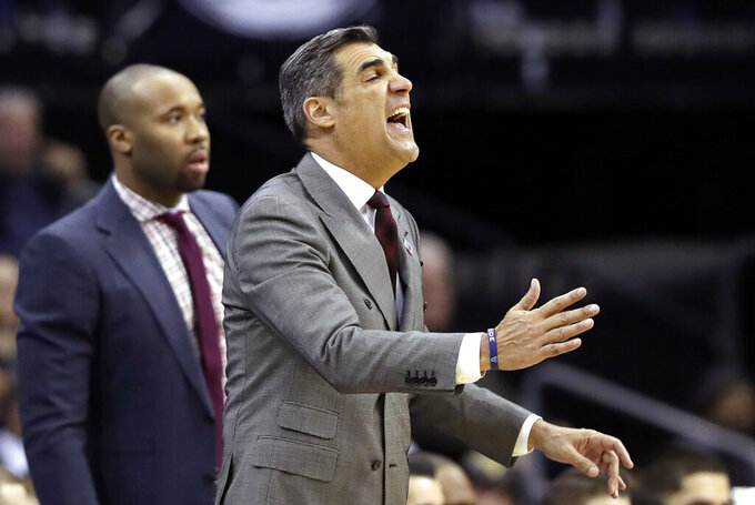 Villanova head coach Jay Wright, right, yells at his players during the second half of an NCAA college basketball game against the Seton Hall, Saturday, March 9, 2019, in Newark, N.J. Seton Hall defeated Villanova 79-75. (AP Photo/Kathy Willens)