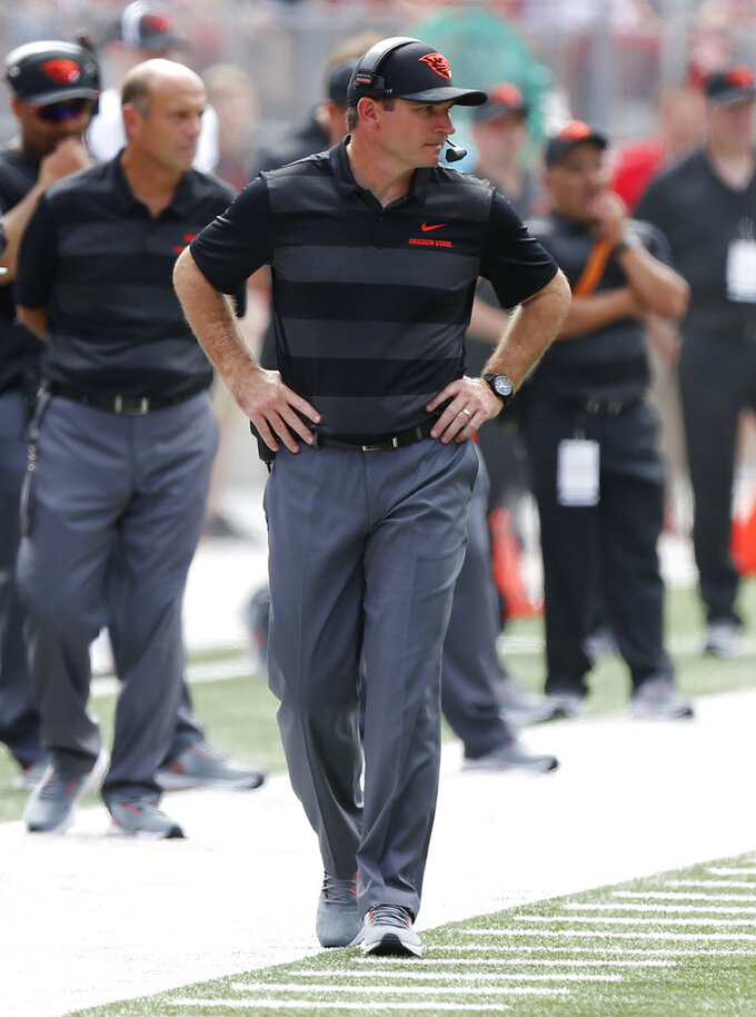 Oregon State head coach Jonathan Smith paces the sideline against Ohio State during the first half of an NCAA college football game Saturday, Sept. 1, 2018, in Columbus, Ohio. (AP Photo/Jay LaPrete)