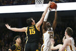 Iowa's Ryan Kriener (15) blocks the shot of Minnesota's Daniel Oturu (25) during an NCAA college basketball game Sunday, Feb. 16, 2020, in Minneapolis. (AP Photo/Stacy Bengs)
