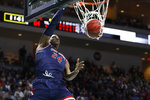 Saint Mary's Malik Fitts (24) dunks against Gonzaga in the second half of an NCAA college basketball game in the final of the West Coast Conference men's tournament Tuesday, March 10, 2020, in Las Vegas. (AP Photo/John Locher)