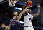 Villanova's Dhamir Cosby-Roundtree (21) blocks a shot by St. Mary's Jordan Ford (3) during the first half of a first round men's college basketball game in the NCAA Tournament, Thursday, March 21, 2019, in Hartford, Conn. (AP Photo/Elise Amendola)