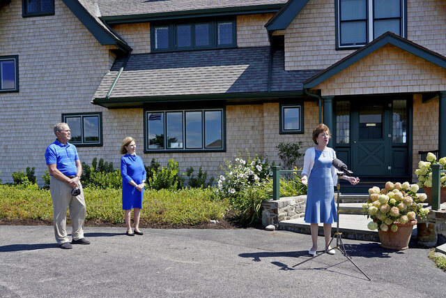 Sen. Susan Collins, R-Maine, right, speaks at a microphone after having lunch with former President George W. Bush and his wife Laura Bush, Friday, Aug. 21, 2020, in Kennebunkport, Maine. (AP Photo/Mary Schwalm)
