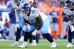 FILE - In this Oct. 13, 2019, file photo, Tennessee Titans offensive guard Rodger Saffold gets set at the line of scrimmage during the second half of an NFL football game against the Denver Broncos in Denver.  Titans already are way ahead of where they were a year ago.  (AP Photo/Jack Dempsey, File)
