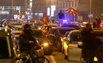 People drive cars honking and wave national flags during an opposition protest through a street in Skopje, North Macedonia, late Thursday, Nov. 26, 2020. Main conservative opposition leader Hristijan Mickoski has called late on Thursday leftist Prime minister Zoran Zaev to resign after his controversial interview given to one Bulgarian media in which he mitigated Bulgaria's occupation role in then Macedonia during the World War II. (AP Photo/Boris Grdanoski)