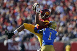 Southern California wide receiver Michael Pittman Jr. (6) makes a catch over UCLA defensive back Darnay Holmes (1) during the first half of an NCAA college football game, Saturday, Nov. 23, 2019, in Los Angeles. (AP Photo/Marcio Jose Sanchez)