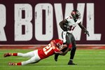 Tampa Bay Buccaneers wide receiver Chris Godwin is tackled by Kansas City Chiefs cornerback Bashaud Breeland during the first half of the NFL Super Bowl 55 football game Sunday, Feb. 7, 2021, in Tampa, Fla. (AP Photo/David J. Phillip)