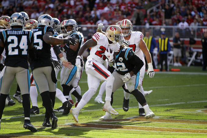 San Francisco 49ers running back Tevin Coleman scores a touchdown during the second half of an NFL football game against the Carolina Panthers in Santa Clara, Calif., Sunday, Oct. 27, 2019. (AP Photo/Ben Margot)