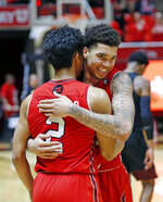Utah forward Timmy Allen, rear, and guard Sedrick Barefield (2) hug following the team's NCAA college basketball game against Southern California on Thursday, March 7, 2019, in Salt Lake City. (AP Photo/Rick Bowmer)