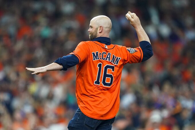 Brian McCann throws out a ceremonial first pitch before Game 1 of the baseball World Series between the Houston Astros and the Washington Nationals Tuesday, Oct. 22, 2019, in Houston. (AP Photo/David J. Phillip)