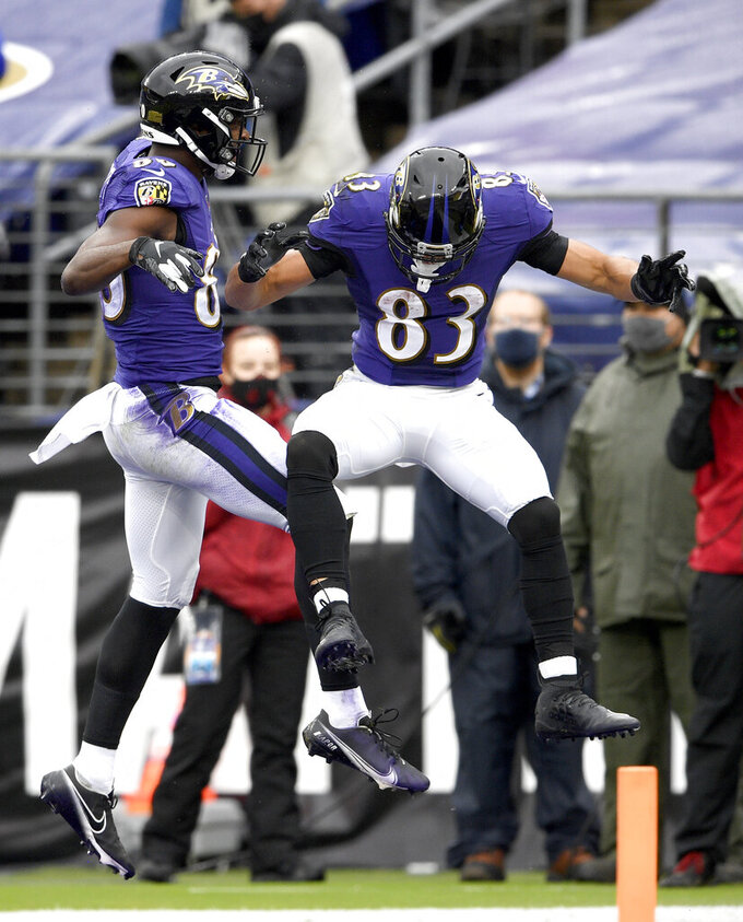 Baltimore Ravens wide receiver Miles Boykin, left, celebrates his touchdown catch with wide receiver Willie Snead (83) during the first half of an NFL football game against the Pittsburgh Steelers, Sunday, Nov. 1, 2020, in Baltimore. (AP Photo/Nick Wass)