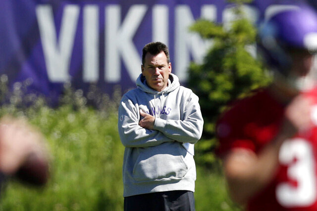 FILE - In this June 13, 2019, file photo, Minnesota Vikings assistant head coach and offensive advisor Gary Kubiak watches quarterbacks during drills at the team's NFL football training facility in Eagan, Minn. As coach Mike Zimmer prepares for his eighth season with the Minnesota Vikings, he might need to hire yet another offensive coordinator with Gary Kubiak uncertain to return. (AP Photo/Andy Clayton- King, File)