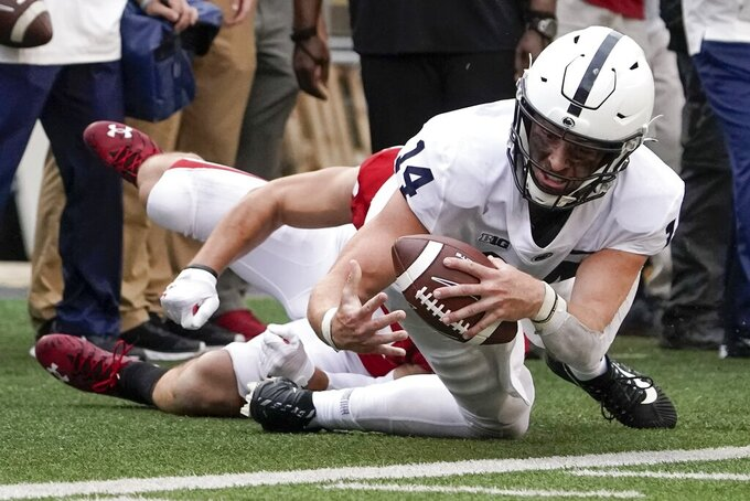 Wisconsin's John Torchio Penn State's Sean Clifford during the second half of an NCAA college football game Saturday, Sept. 4, 2021, in Madison, Wis. (AP Photo/Morry Gash)