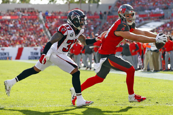 Tampa Bay Buccaneers tight end Cameron Brate (84) beats Atlanta Falcons free safety Ricardo Allen (37) to the endzone to score on a 2-yard touchdown reception during the first half of an NFL football game Sunday, Dec. 29, 2019, in Tampa, Fla. (AP Photo/Mark LoMoglio)