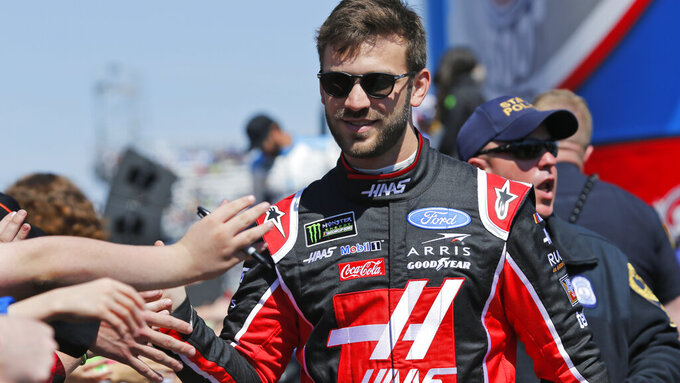 NASCAR Cup Series driver Daniel Suarez (41) greets fans during driver introductions prior to the NASCAR Cup Series auto race at the Martinsville Speedway in Martinsville, Va., Sunday, March 24, 2019. (AP Photo/Steve Helber)