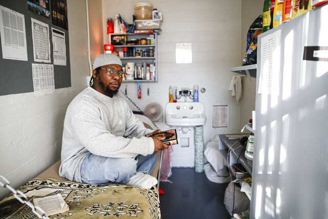 In this Thursday, Feb. 13, 2020 photo, Myon Burrell sits inside his cell at the Minnesota Correctional Facility in Stillwater. On Thursday, March 5, 2020, Sen. Amy Klobuchar, D-Minn., called for an independent probe of the murder case she prosecuted that sent a teenage Burrell to prison for life. (AP Photo/John Minchillo)