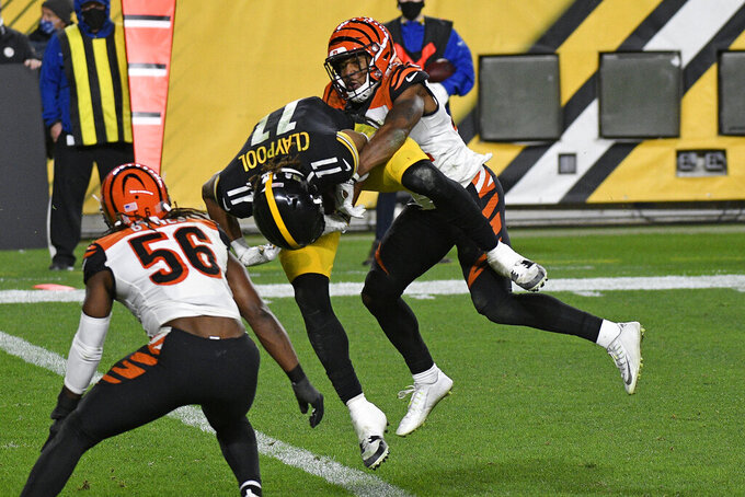 Pittsburgh Steelers wide receiver Chase Claypool (11) scores on an 11-yard pass from quarterback Ben Roethlisberger with Cincinnati Bengals strong safety Vonn Bell (24) defending during the second half of an NFL football game in Pittsburgh, Sunday, Nov. 15, 2020. (AP Photo/Don Wright)
