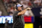 UCLA coach Chip Kelly gestures during the first half of the team's NCAA college football game against Arizona on Saturday, Oct. 9, 2021, in Tucson, Ariz. (AP Photo/Chris Coduto)